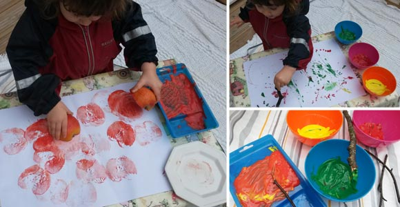 Apple printing and painting with sticks