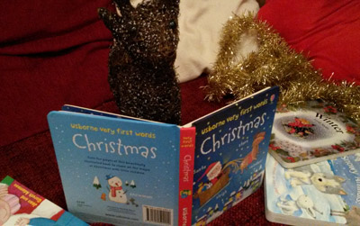 Rosie reading Christmas books