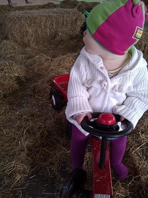 Supervising on her tractor