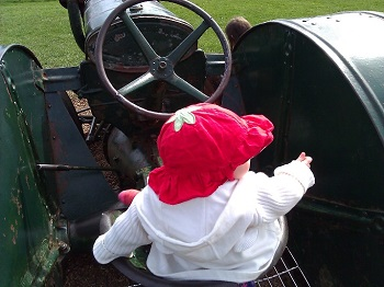 Baby E on tractor